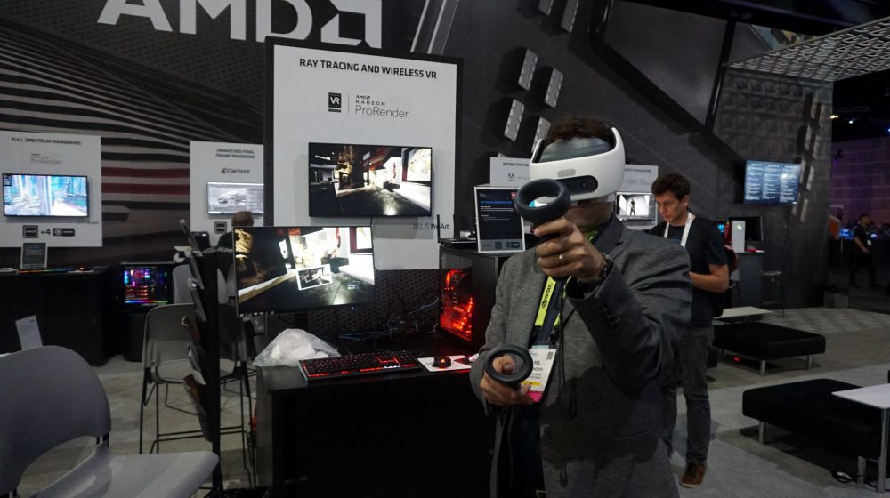 Neil trying wireless VR at AMD SIGGRAPH 2019 booth.